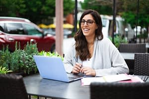 woman working from table outside